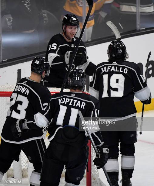 Ben Hutton of the Los Angeles Kings celebrates his goal with Alex Iafallo, Anze Kopitar and Dustin Brown, to take a 5-4 lead over the Florida...
