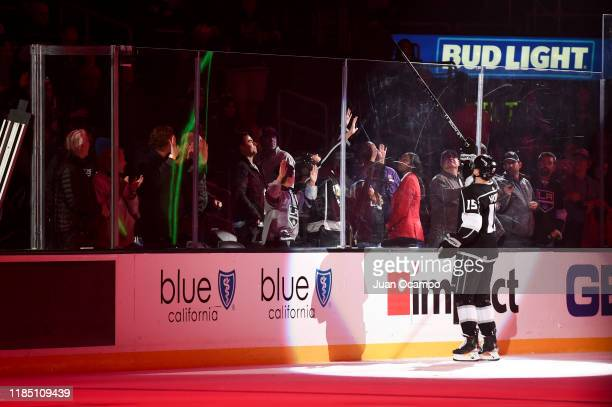 Ben Hutton of the Los Angeles Kings gives a fan his stick after their victory against the New York Islanders at STAPLES Center on November 27, 2019...