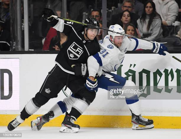 Ben Hutton of the Los Angeles Kings knocks Steven Stamkos of the Tampa Bay Lightning off stride during the first period at Staples Center on January...