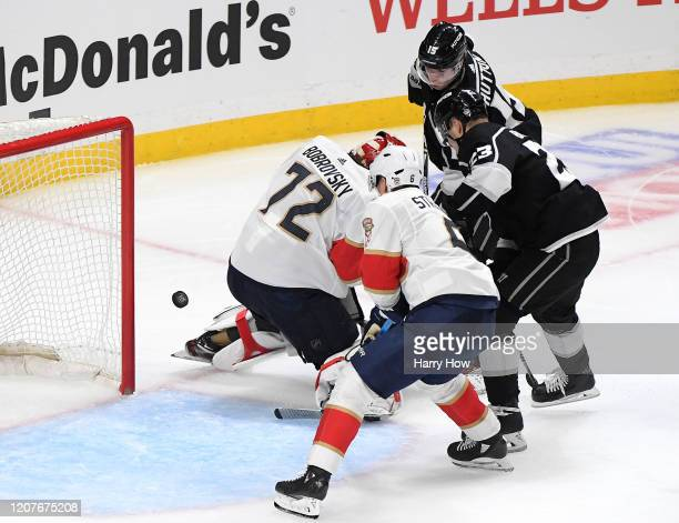 Ben Hutton of the Los Angeles Kings scores a goal on Sergei Bobrovsky of the Florida Panthers to take a 5-4 lead during the third period in a 5-4...