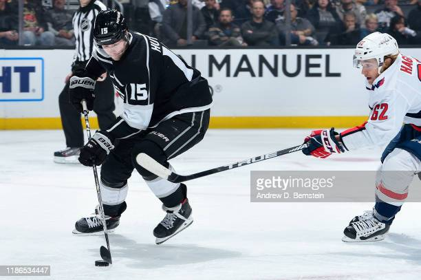 Ben Hutton of the Los Angeles Kings skates with the puck with pressure from Carl Hagelin of the Washington Capitalsduring the second period at...