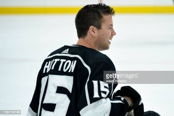 Ben Hutton of the Los Angeles Kings smiles on the ice during warm ups prior to his 300th NFL game against the San Jose Sharks at STAPLES Center on...