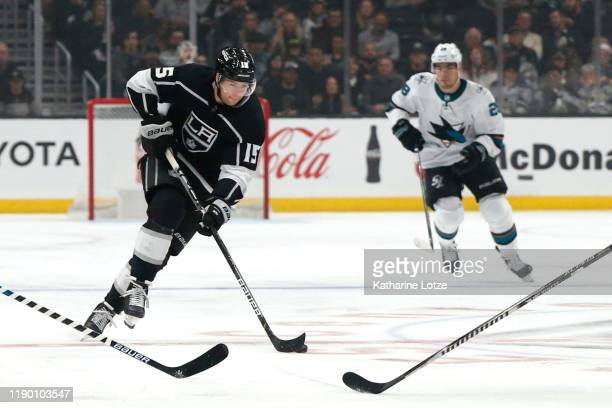 Ben Hutton of the Los Angeles Kings takes the puck down the ice during a game against the San Jose Sharks at Staples Center on November 25, 2019 in...