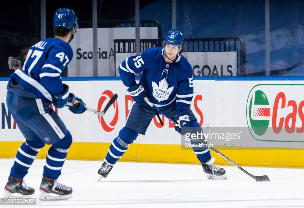 Ben Hutton of the Toronto Maple Leafs plays the puck against the Vancouver Canucks during the first period at the Scotiabank Arena on April 29, 2021...