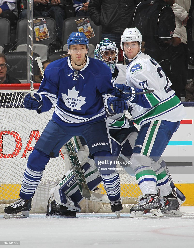 Ben Hutton #27 of the Vancouver Canucks battles against James van Riemsdyk #21 of the Toronto Maple Leafs during an NHL game at the Air Canada Centre on November 14, 2015 in Toronto, Ontario, Canada. The Leafs defeated the Canucks 4-2.