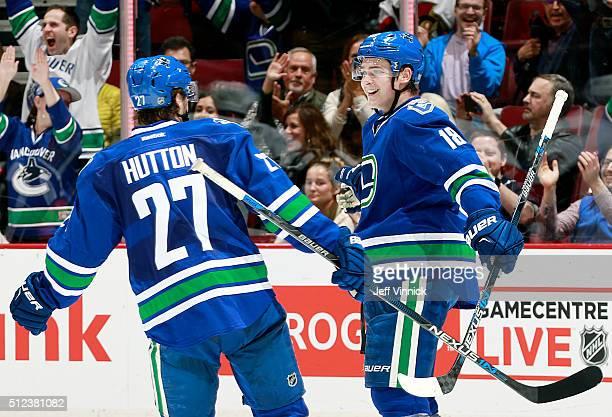 Ben Hutton of the Vancouver Canucks congratulatesJake Virtanen who scored against the Ottawa Senators during their NHL game at Rogers Arena February...