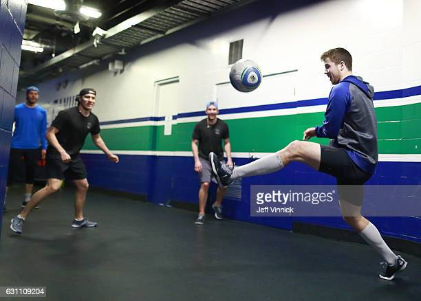 Ben Hutton of the Vancouver Canucks plays soccer with teammates Jacob Markstrom Markus Granlund and Sven Baertschi before their NHL game against the...