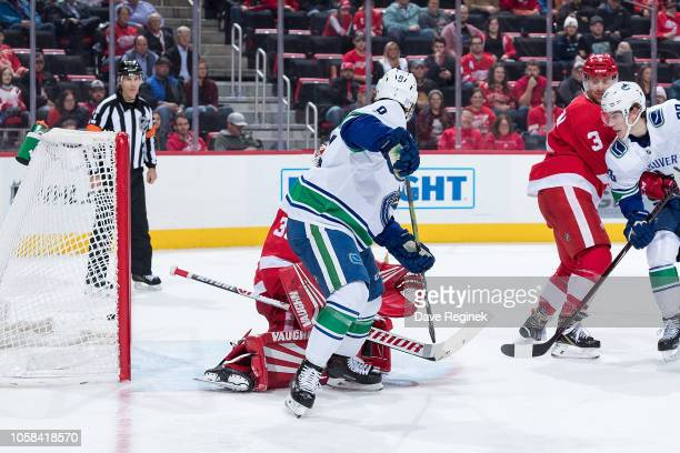 Ben Hutton of the Vancouver Canucks scores a second period goal past Jimmy Howard of the Detroit Red Wings during an NHL game at Little Caesars Arena...