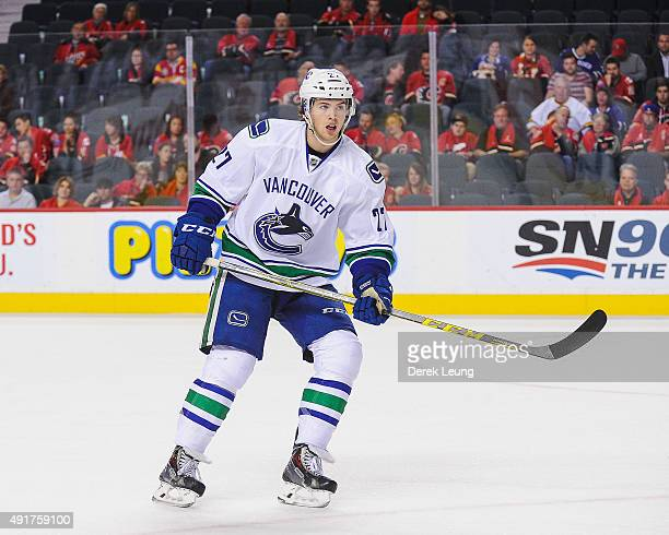 Ben Hutton of the Vancouver Canucks skates against the Calgary Flames in the season opener at Scotiabank Saddledome on October 7 2015 in Calgary...