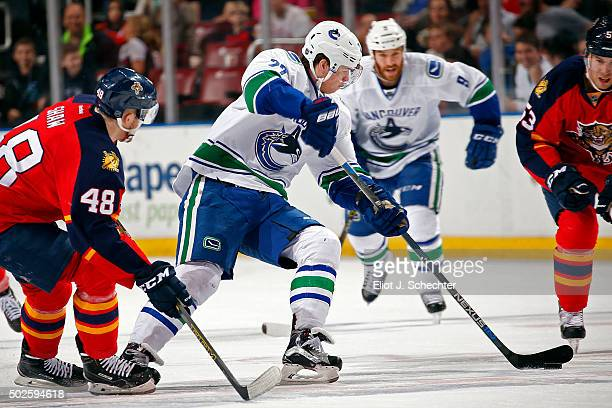Ben Hutton of the Vancouver Canucks skates with the puck against the Florida Panthers at the BBT Center on December 20 2015 in Sunrise Florida