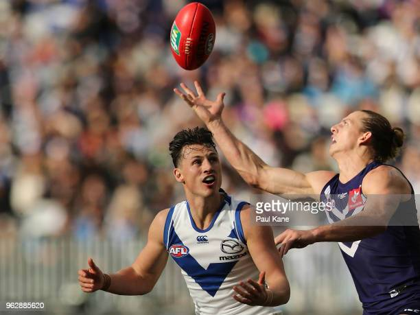 Ben Jacobs of the Kangaroos and Nathan Fyfe of the Dockers contest for the ball during the round 10 AFL match between the Fremantle Dockers and the...