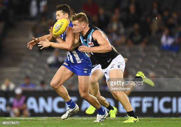 Ben Jacobs of the Kangaroos and Ollie Wines of the Power compete for the ball during the round six AFL match between the North Melbourne Kangaroos...