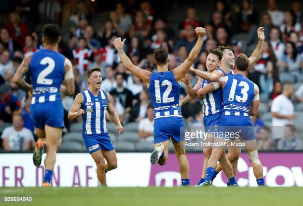 Ben Jacobs of the Kangaroos celebrates a goal during the 2018 AFL round 02 Good Friday Kick for the Kids match between the North Melbourne Kangaroos...