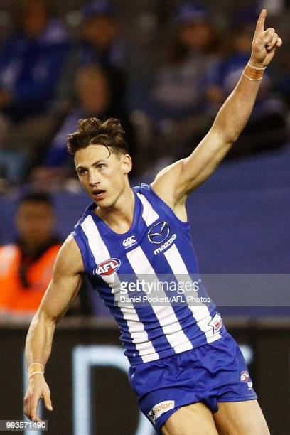 Ben Jacobs of the Kangaroos celebrates a goal during the round 16 AFL match between the North Melbourne Kangaroos and the Gold Coast Titans at Etihad...