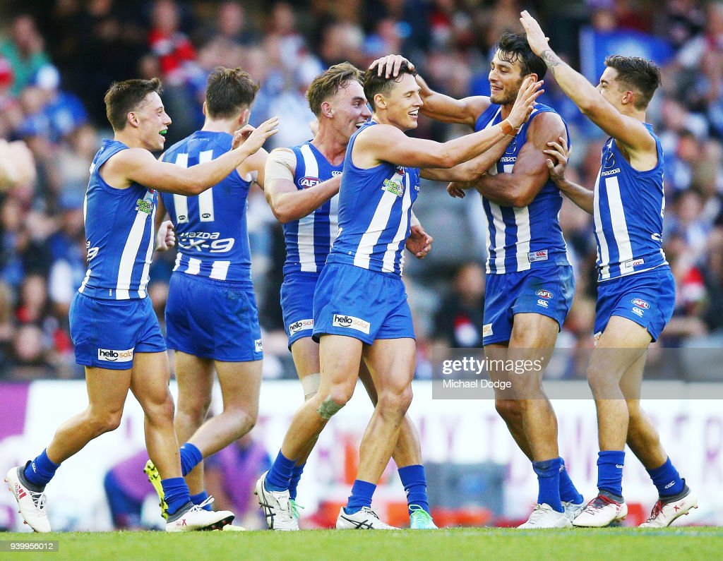 Ben Jacobs of the Kangaroos celebrates a goal with teammates during the round two AFL match between the North Melbourne Kangaroos and the St Kilda Saints at Etihad Stadium on March 30, 2018 in Melbourne, Australia.