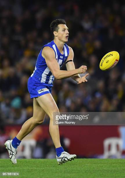 Ben Jacobs of the Kangaroos handballs during the round eight AFL match between the North Melbourne Kangaroos and the Richmond Tigers at Etihad...