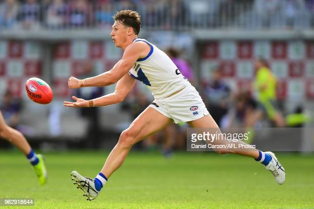 Ben Jacobs of the Kangaroos handpasses the ball during the 2018 AFL round 10 match between the Fremantle Dockers and the North Melbourne Kangaroos at...