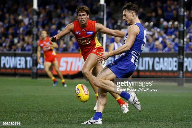 Ben Jacobs of the Kangaroos kicks the ball during the round 16 AFL match between the North Melbourne Kangaroos and the Gold Coast Titans at Etihad...