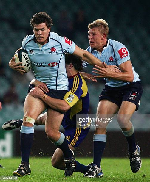 Ben Jacobs of the Waratahs is tackled during the round 12 Super 14 match between the Waratahs and the Highlanders at Aussie Stadium on April 21, 2007...