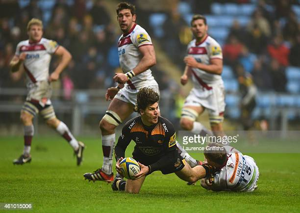 Ben Jacobs of Wasps is tackled by Mike Haley of Sale during the Aviva Premiership match between Wasps and Sale Sharks at The Ricoh Arena on January 4...
