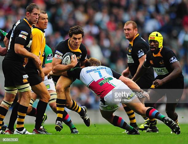 Ben Jacobs of Wasps is tackled by Will Skinner of Harlequins during the Guinness Premiership match between London Wasps and Harlequins at Twickenham...