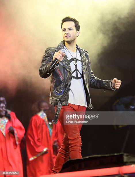 Ben Jaimen performs at the Brandenburg Gate New Years Eve Party on December 31 2014 in Berlin Germany