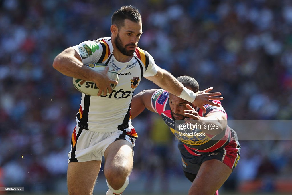 Ben Jeffries (L) of Bradford Bulls fends off Jamie Jones-Buchanan (R) of Leeds Rhinos to score his sides second try during the Stobart Super League 'Magic Weekend' match between Bradford Bulls and Leeds Rhinos at the Etihad Stadium on May 27, 2012 in Manchester, England.