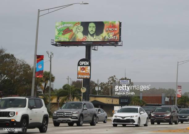 Ben & Jerry's billboard advertisement featuring former NFL quarterback Colin Kaepernick is seen near Raymond James Stadium prior to Super Bowl LV on...