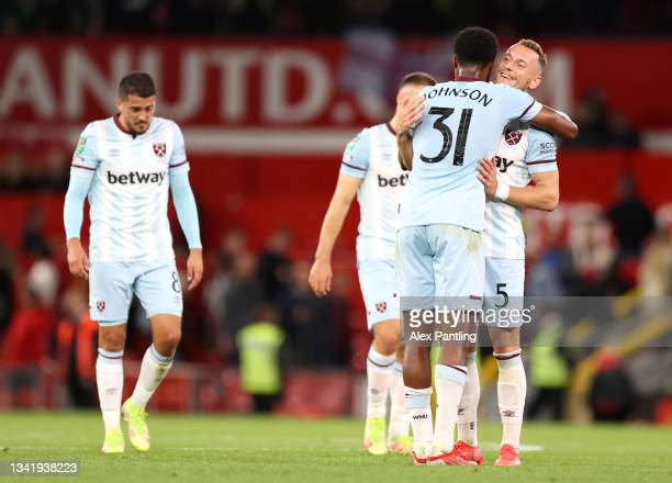 Ben Johnson celebrates with Vladimir Coufal of West Ham United after their sides victory in the Carabao Cup Third Round match between Manchester...