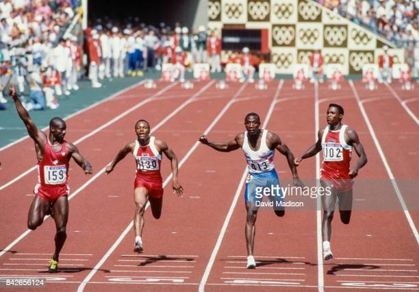 Ben Johnson of Canada Calvin Smith of the USA Linford Christie of Great Britain and Carl Lewis run the final of the Men's 100 meter track event of...