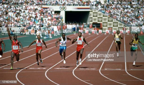 Ben Johnson of Canada celebrates after winning the men's 100 metres final in a world record time of 9.79 during the 1988 Summer Olympics at the Seoul...