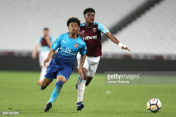 Ben Johnson of West Ham United and Reiss Nelson of Arsenal battle for possession during the Premier League 2 match between West Ham United and...