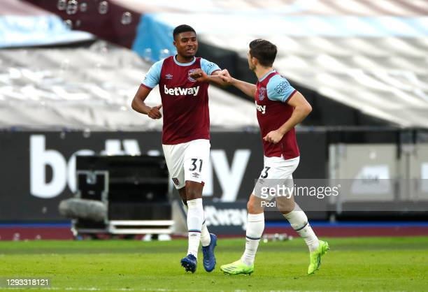 Ben Johnson of West Ham United celebrates with teammate Aaron Cresswell after scoring their team's first goal during the Premier League match between...