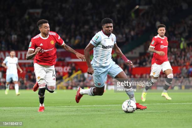 Ben Johnson of West Ham United is closed down by Jesse Lingard of Manchester United during the Carabao Cup Third Round match between Manchester...