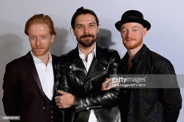 Ben Johnston Simon Neil and James Johnston of Biffy Clyro attend the MTV EMA's 2014 at The Hydro on November 9 2014 in Glasgow Scotland