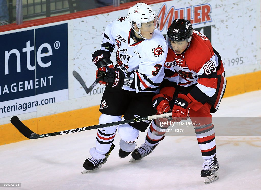 Ben Jones #3 of the Niagara IceDogs battles for the puck with Sasha Chmleveski #89 of the Ottawa 67's during the first period of an OHL game at the Meridian Centre on November 18, 2016 in St Catharines, Canada.