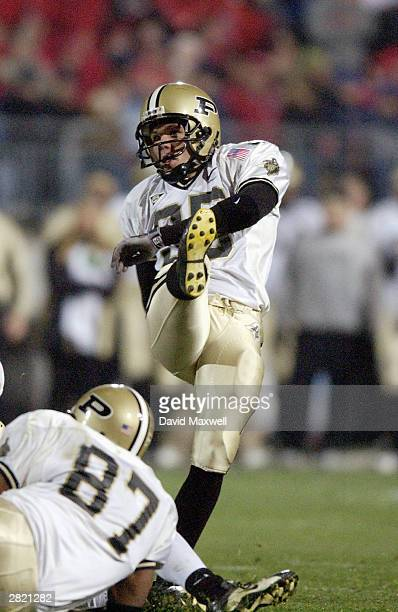 Ben Jones of the Purdue Boilermakers watches the ball after his kick against the Ohio State Buckeyes on November 15 2003 at Ohio Stadium in Columbus...