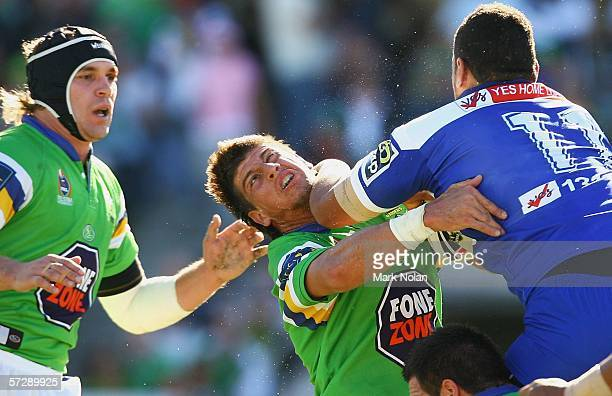 Ben Jones of the Raiders gets an elbow to the head from Willie Mason of the Bulldogs during the round five NRL match between the Canberra Raiders and...