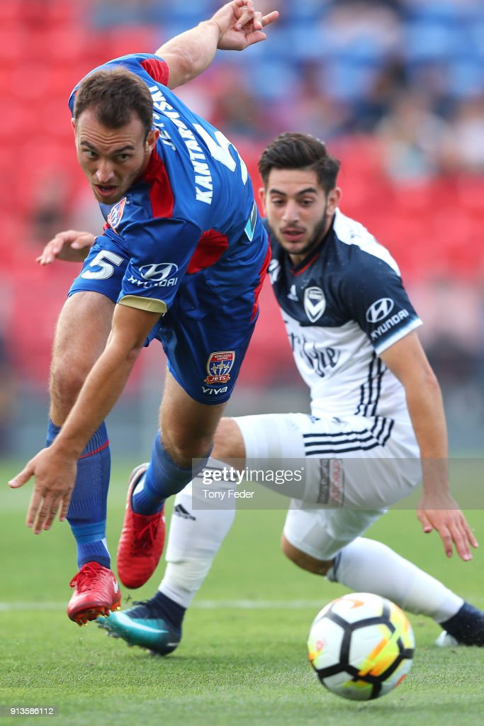 Ben Kantarovski of the Jets contests the ball with Christian Theoharous of the Victory during the round 19 A-League match between the Newcastle Jets and the Melbourne Victory at McDonald Jones Stadium on February 3, 2018 in Newcastle, Australia.