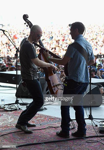 Ben Kaufmann and Dave Johnston of Yonder Mountain String Band perform onstage at What Stage during day 4 of the 2014 Bonnaroo Arts And Music Festival...