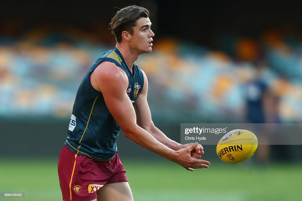 Ben Keays handballs during the Brisbane Lions AFL training session at The Gabba on May 17, 2018 in Brisbane, Australia.
