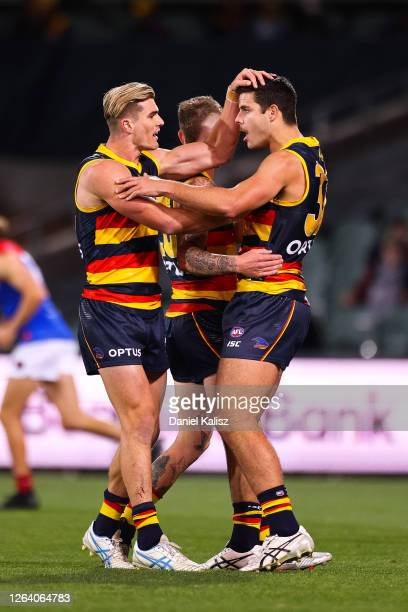 Ben Keays of the Crows and Darcy Fogarty of the Crows celebrate during the round 10 AFL match between the Adelaide Crows and the Melbourne Demons at...