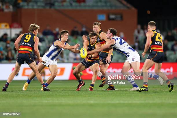 Ben Keays of the Crows handballs during the round 23 AFL match between Adelaide Crows and North Melbourne Kangaroos at Adelaide Oval on August 22,...