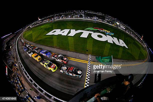 Ben Kennedy driver of the Florida Lottery/Whelen Chevrolet leads the field to the green flag to start the Camping World Truck Series NextEra Energy...