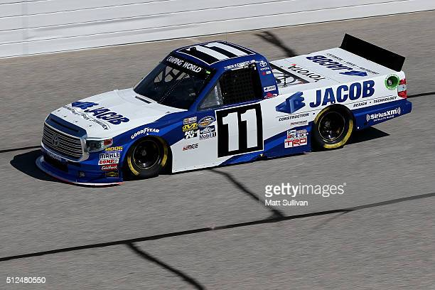 Ben Kennedy driver of the JACOB Companies Toyota practices for the NASCAR Camping World Truck Series Great Clips 200 at Atlanta Motor Speedway on...