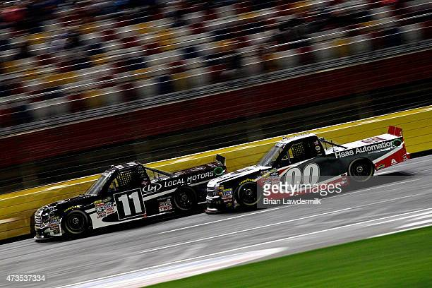 Ben Kennedy driver of the Local Motors Toyota races Kasey Kahne driver of the Haas Automation Chevrolet during the NASCAR Camping World Truck Series...