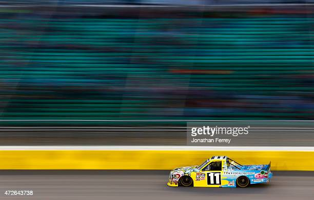 Ben Kennedy driver of the Local Motors/SpongeBob SquarePants Toyota races during the NASCAR Camping World Truck Series Toyota Tundra 250 at Kansas...