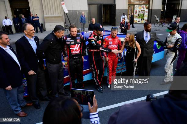 Ben Kennedy driver of the No 9 Rheem Chevrolet reaches to shake hands with Sheila Hess City Representative on May 9 2017 in Philadelphia Pennsylvania...