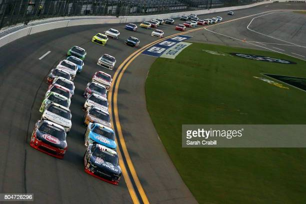 Ben Kennedy driver of the Rheem Chevrolet and Brennan Poole driver of the DC Solar Chevrolet lead the field during the NASCAR XFINITY Series CocaCola...