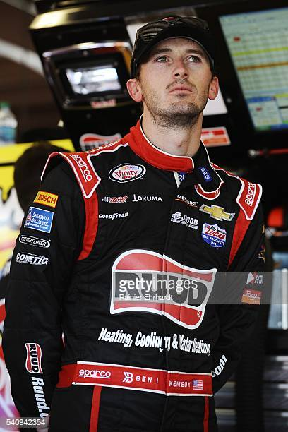 Ben Kennedy driver of the Ruud Chevrolet stands in the garage area during practice for the NASCAR Xfinity Series American Ethanol E15 250 presented...